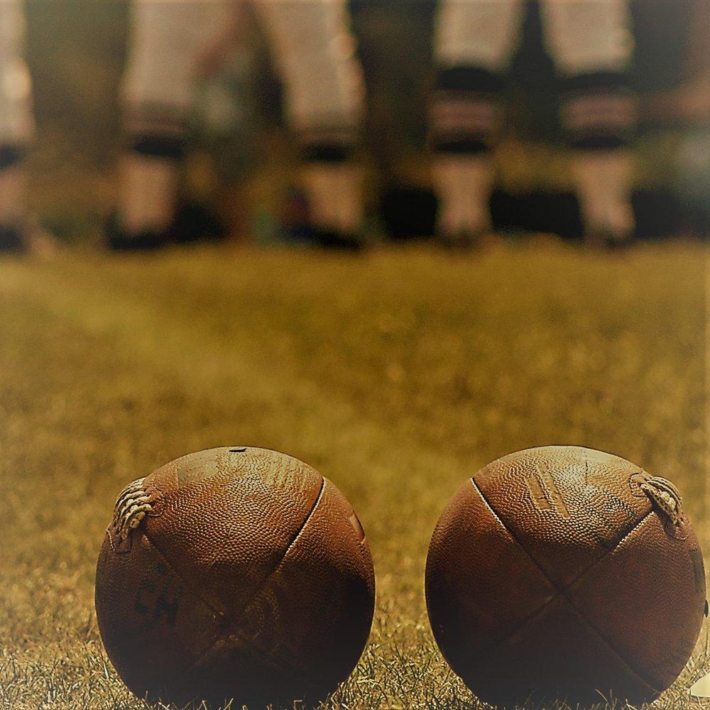 2 footballs.jpg
