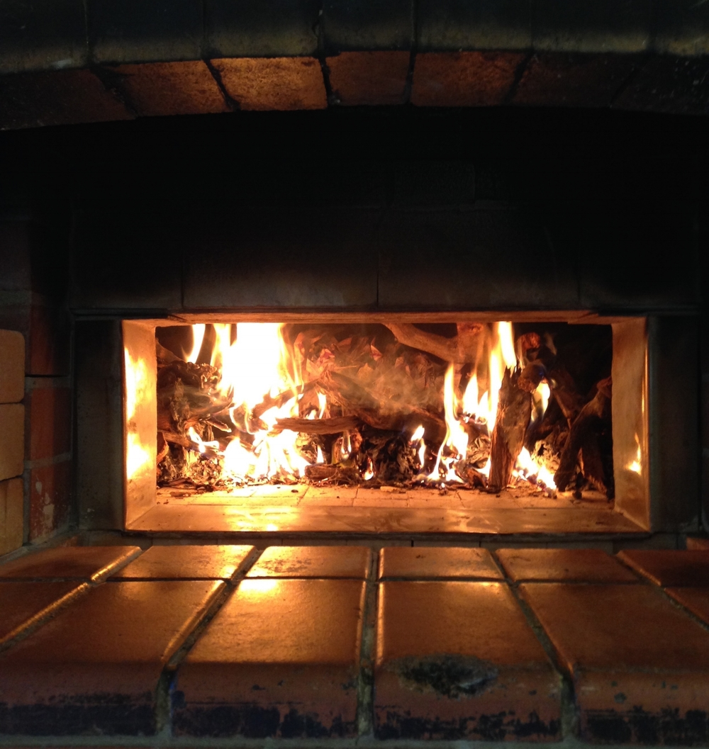 24 hours before we make the final dough, the oven is loaded with wood and lit.