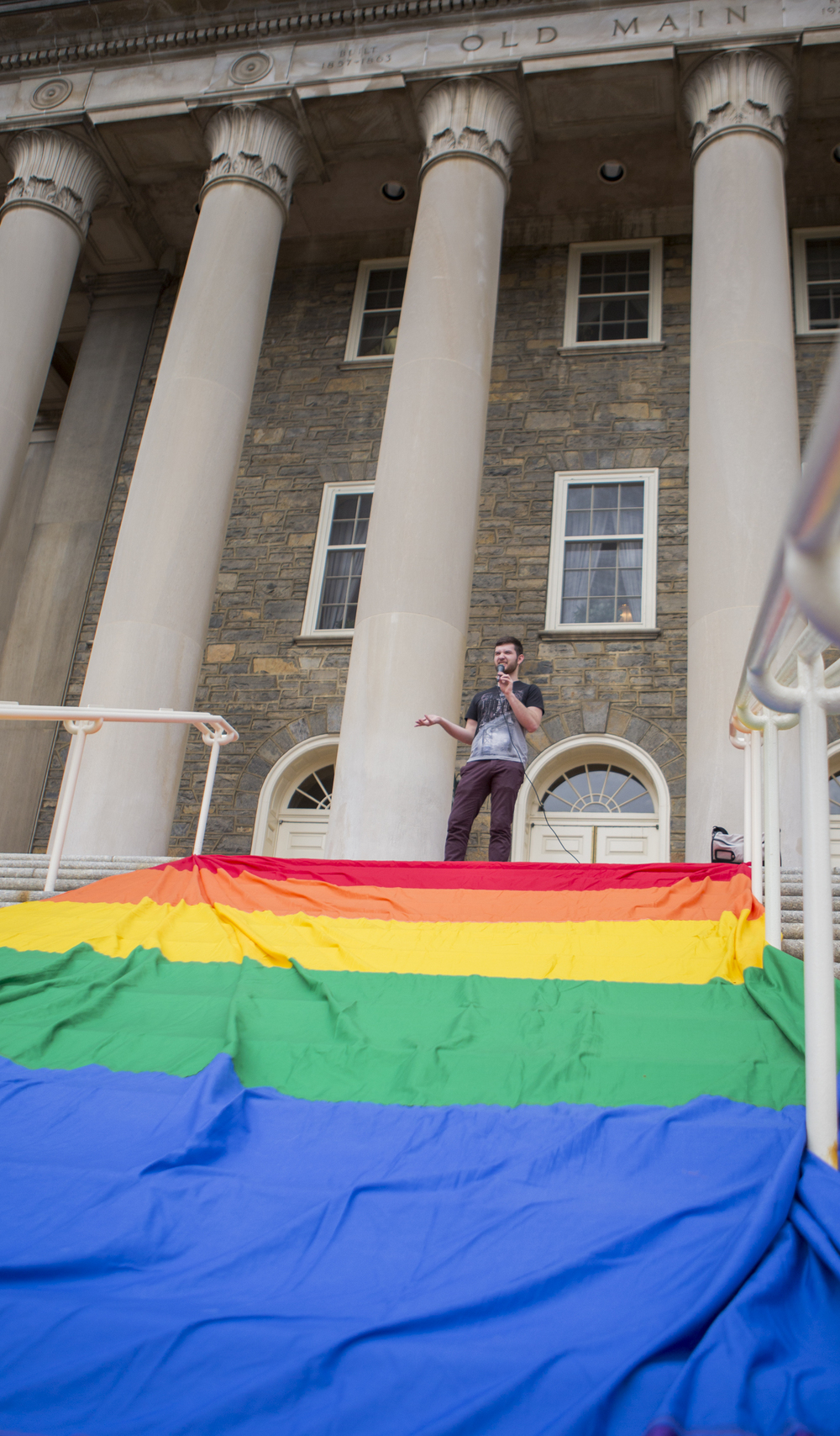 LGBTQA Resouce Center programming intern Nate Pentz (junior - sociology) kicks off the Pride Week Pride Rally on the steps of Old Main on Wednesday, March 23, 2016.