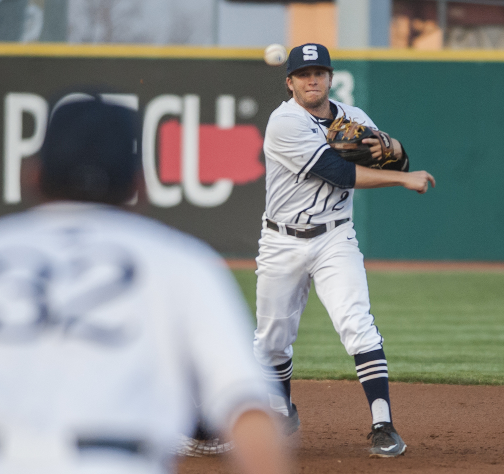 Freshman second baseman Conlin Hughes throws to senior first baseman Tyler Kendall to attempt a triple play against Rhode Island at Medlar Field on Wednesday, March 23, 2016