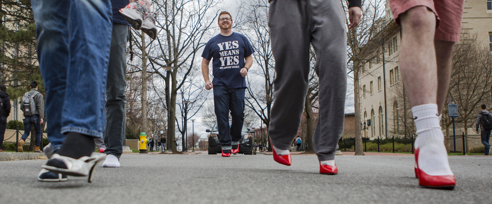 Director of Men Against Violence, Tim Donovan (graduate - higher education) brings up the rear of the Walk a Mile in Her Shoes march on Pollock Street on Monday, March 28, 2016.