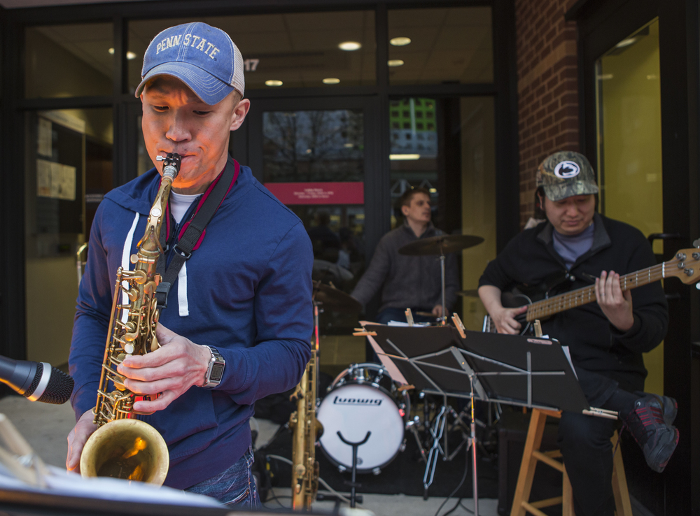 Ben Kim plays his alto saxophone with Boemsoo Kim on bass and Ed Tomany on the drums make up the Big Coronas Band along with Skip Wareham (not pictured) as they perform on Allen Street for First Friday on Friday, April 1, 2016.