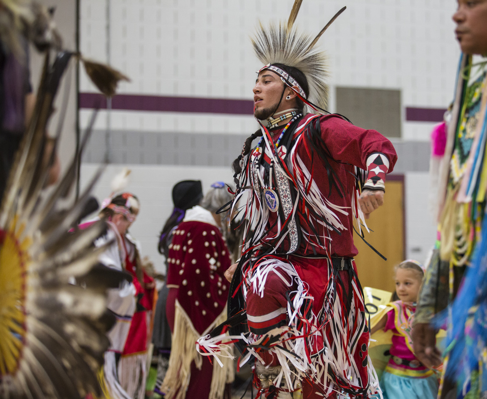 Oran Irwin of Columbis, Ohio participates in a traditional intertribal dance during the during the New Faces of Ancient People Powwow at Mount Nittany Middle School on Saturday, April 2, 2016.