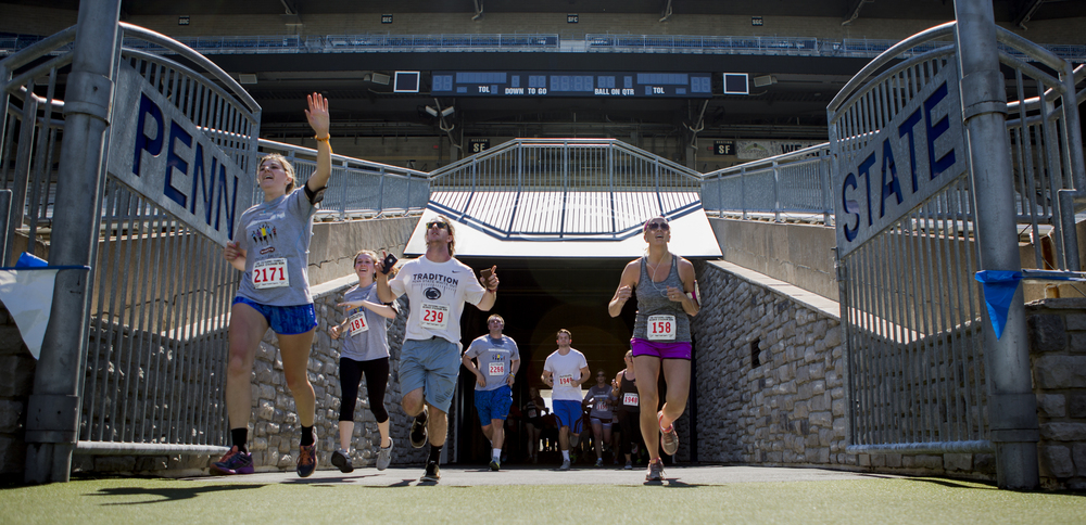Participants of the annual Paterno Family Beaver Stadium Run enter Beaver Stadium through the player's tunnel for the final stretch of the run on Sunday, April 17, 2016.