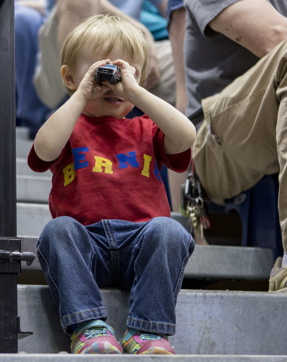 Two and a half year old Waylon Myers plays with his trucks in the stands of Rec Hall during democratic presidential candidate Sen. Bernie Sanders' campaign rally on Tuesday, April 19, 2016.