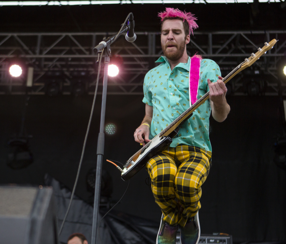 Bassist William Hehir performs with Misterwives at Movin' On Music Festival on the IM fields on Friday, April 29, 2016.