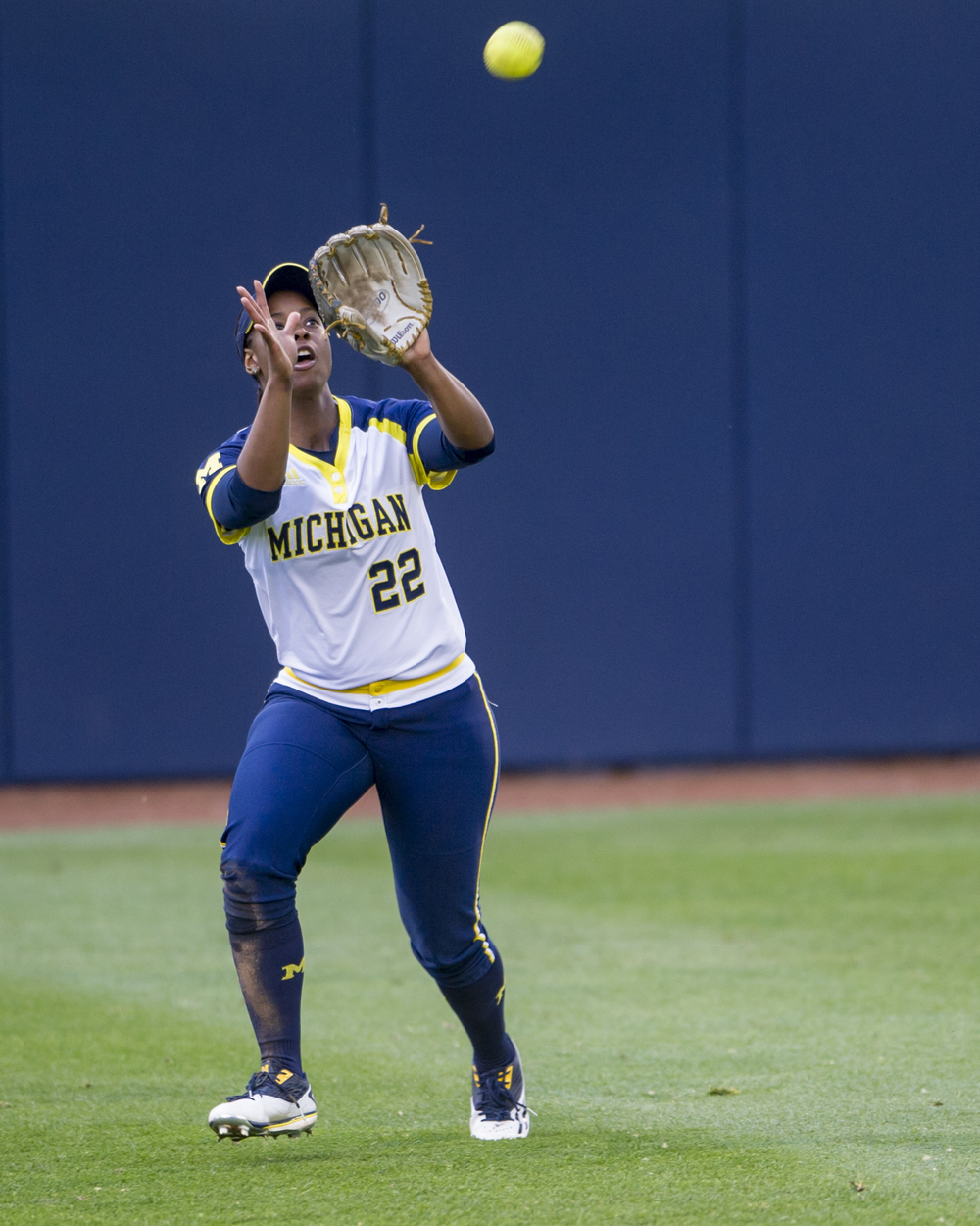 Michigan center fielder Sierra Lawrence lines up to catch a fly ball during the team's semifinal game against Penn State in the Big Ten Tournament at Beard Field on Saturday, May 14, 2016. Michigan won the game 7-1.