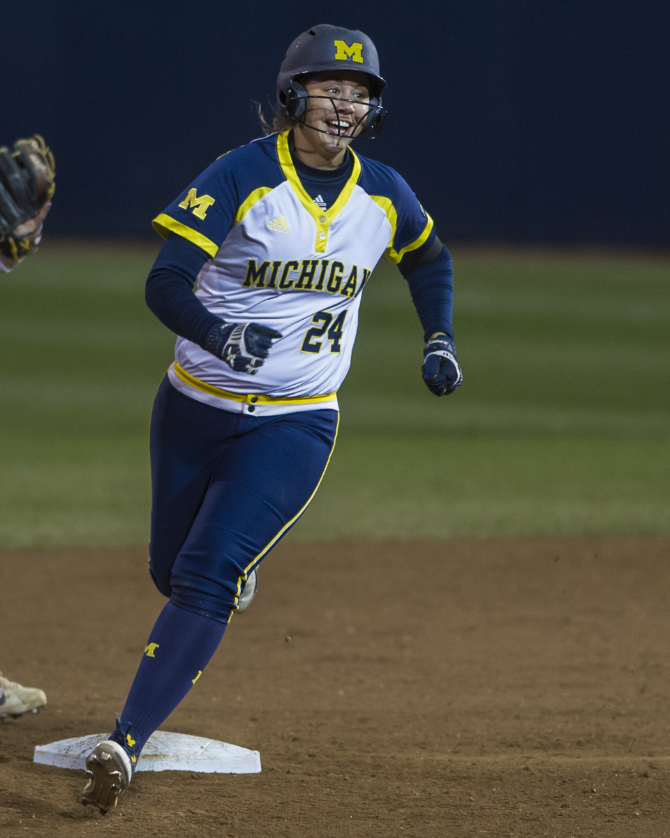 Michigan first baseman Tera Blanco smiles as she rounds second base after hitting a home run in the final game of the Big Ten Tournament against Minnesota on Saturday, May 14, 2016.