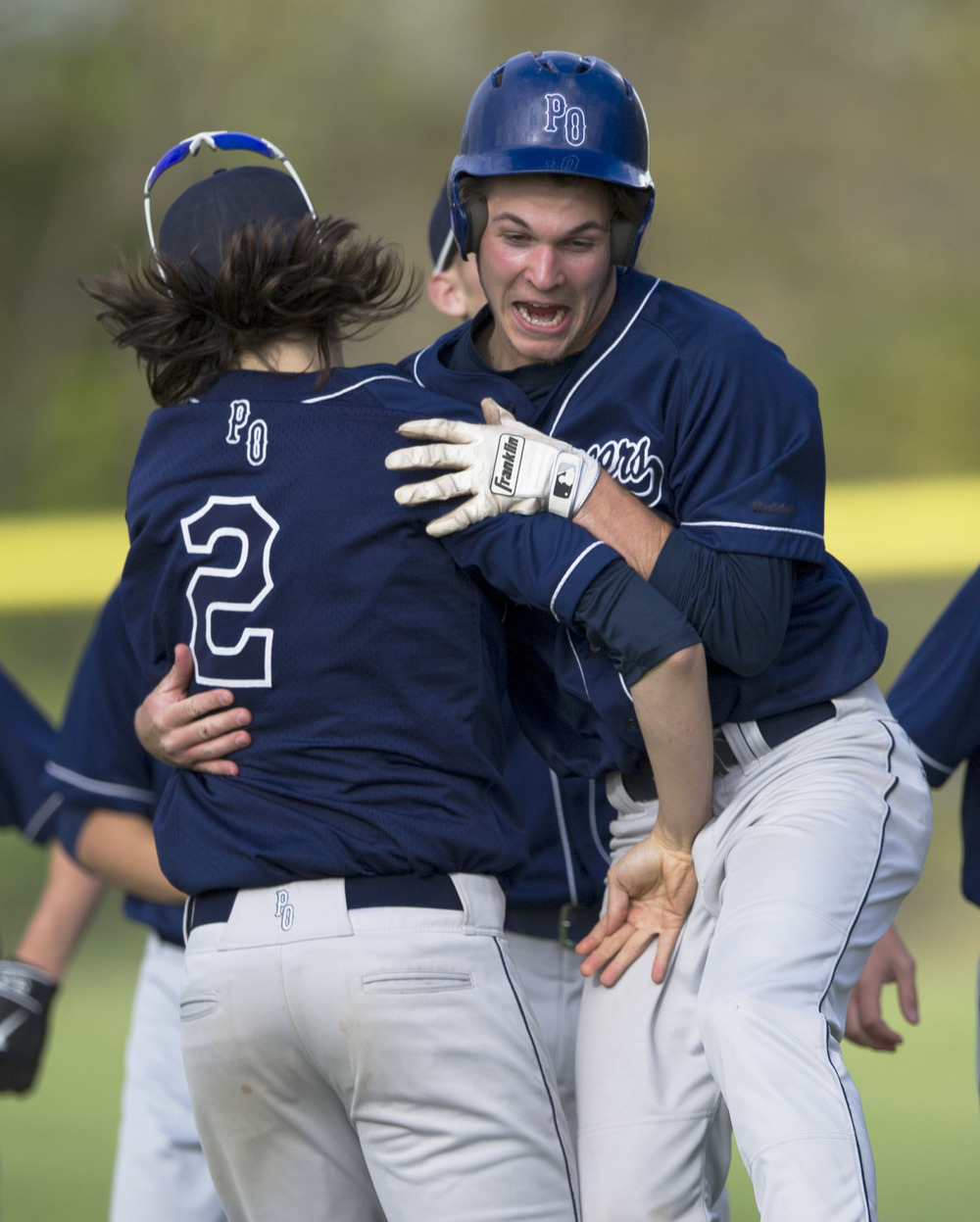 Phillipsburg-Osceola third baseman Noah Jeffries (2) and center fielder Caleb Belinda (23) celebrate after the team's 4-3 victory over Chestnut Ridge in extra innings at Phillipsburg-Osceola High School on Thursday, May 19, 2016.