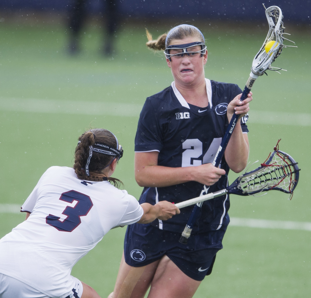 Penn State attacker Madison Carter charges the net while under coverage from Penn defender Katy Junior during the NCAA quarterfinal game at the Lacrosse Stadium on Saturday, May 21, 2016. Penn State won the game 8-4.