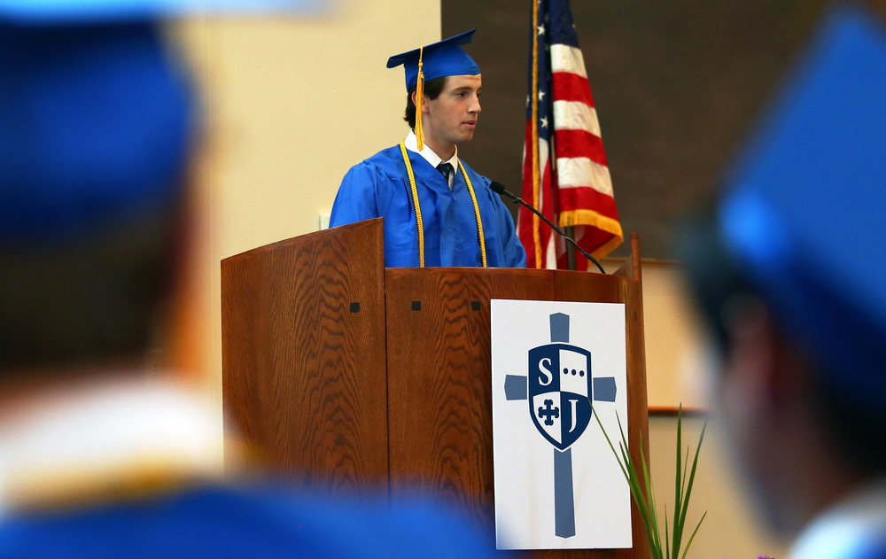 Saint Joseph's Catholic Academy graduating senior Michael Forstmeier speaks to his graduating classmates and audience members during the graduation ceremony at Pasquerilla Spiritual Center on Saturday, May 21, 2016.