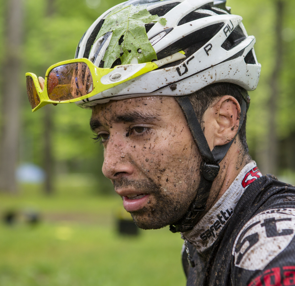 Stradalli team rider David Herrera takes a quick breather after completing the final stage of the Tran-Sylvania Epic Mountain Bike Ride at Seven Mountains Scout Camp on Friday, June 3, 2016.
