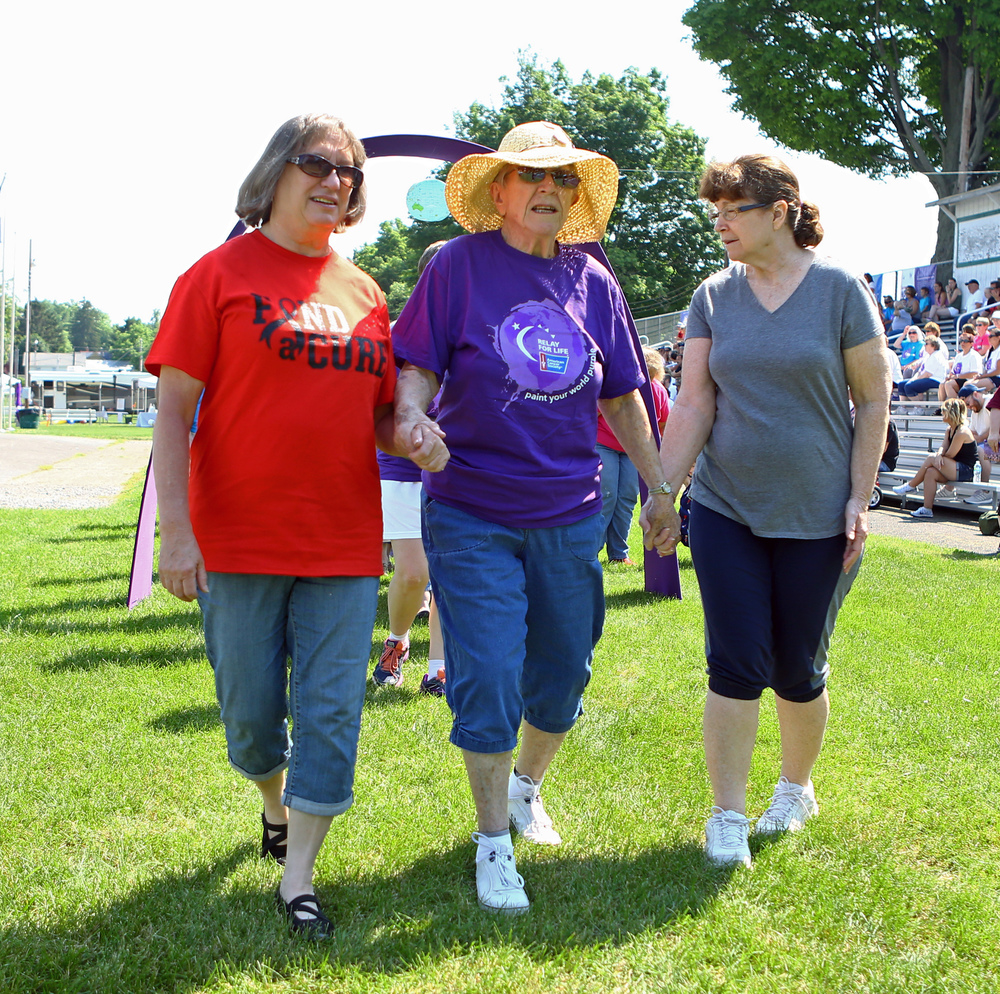 Two time cancer survivor Barbera Shultz is escorted by her nieces Pat Lose and Sherry Smith to start the Happy Valley Relay for Life held at the Grange Fair Grounds on Saturday, June 25, 2016.