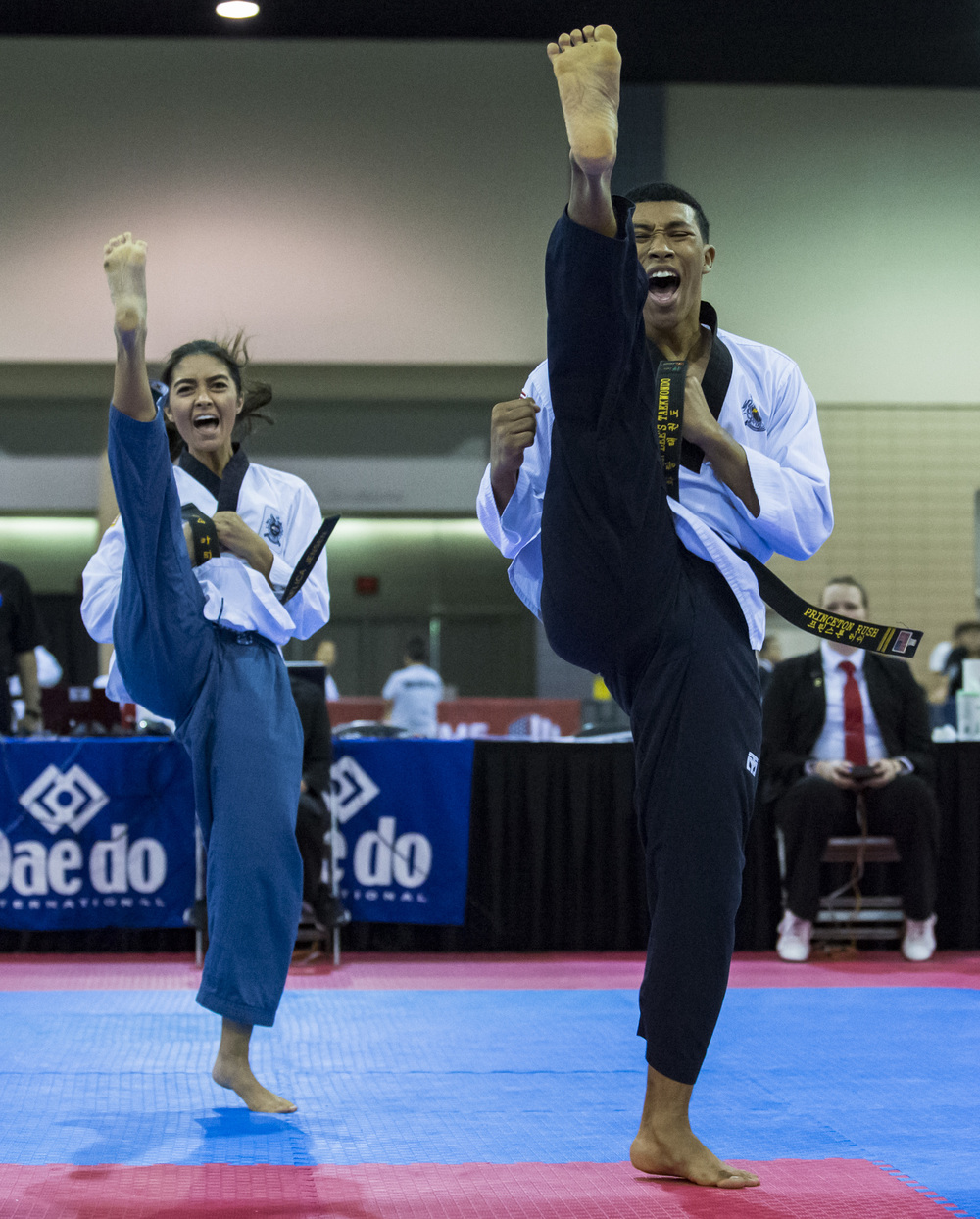 Angelica Jenson, left, and Princeton Rush, right, compete in the world class black belt co-ed poomsae pairs during the USA Taekwondo National Championship in the Greater Richmond Convention Center in Richmond, Va. on Thursday, July 7, 2016.