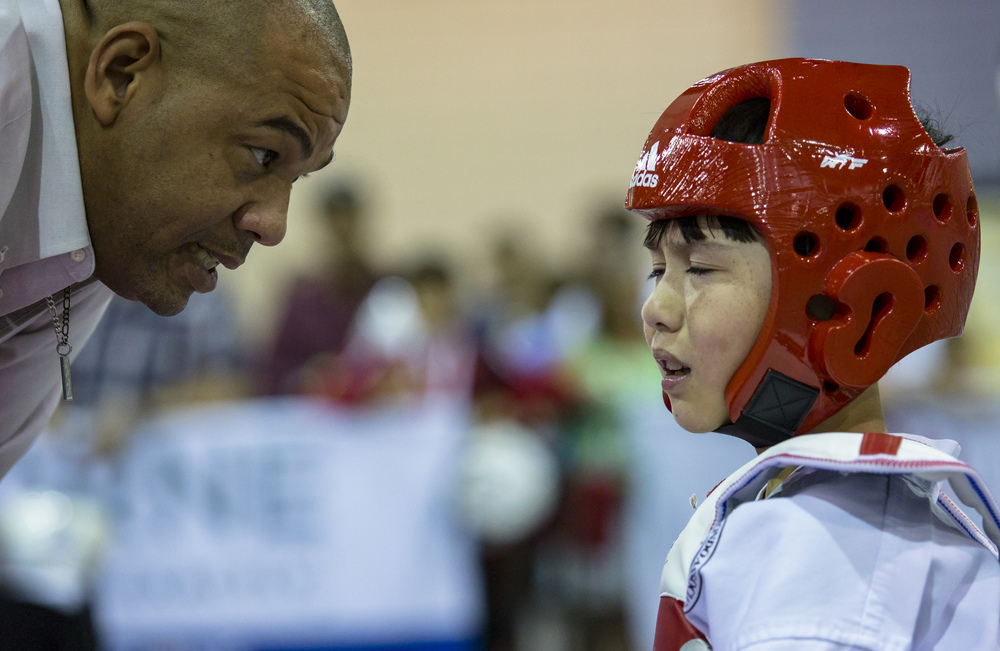 Master Nigel Holder of East West Taekwondo school speaks with a frustrated Alexander Pease between rounds in one of his sparring matches during the 2016 USA Taekwondo National Championships at the Greater Richmond Convention Center on Saturday, July 9, 2016.