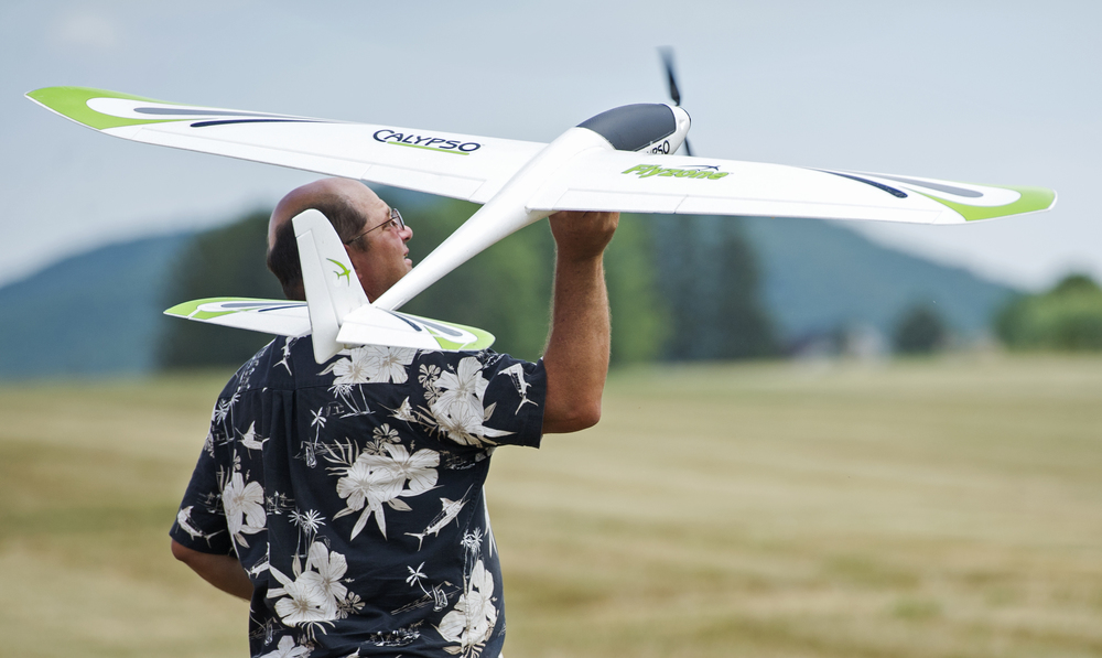 State College Radio Control Club president Jon Guizar of Bellefonte launches his Calypso glider during the glider demonstration portion of the club's air show held at Centre Airpark in Centre Hall on Sunday, July 24, 2016.