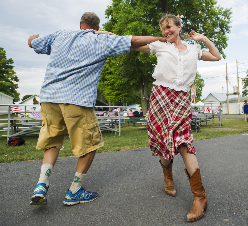 Jean McCracken of Madisonburg dances with Jim Pierce of Cobern during Farm Fest at the Grange Fair Grounds on Friday, July 29, 2016.