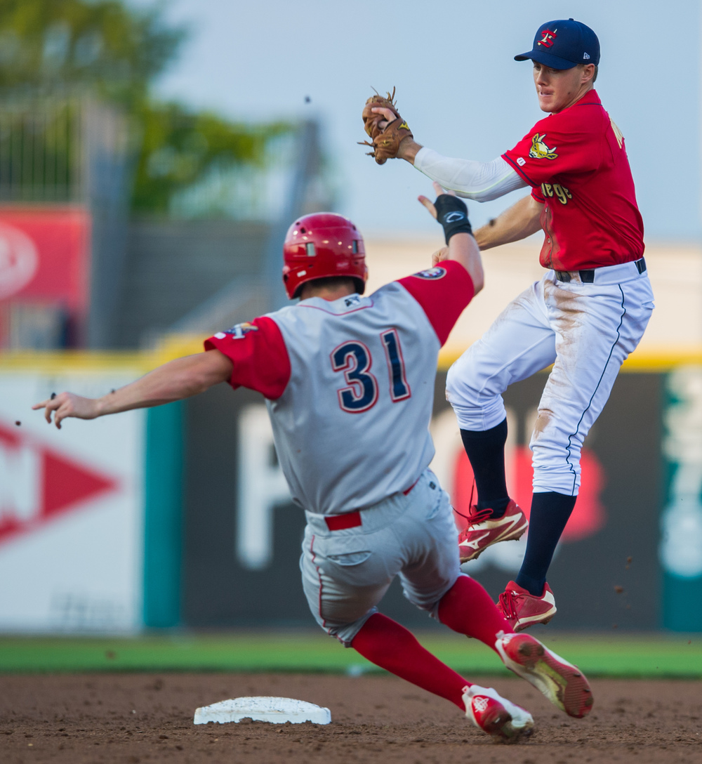 State College Spikes second baseman Danny Martin jumps to catch a throw from the infield to tag out Williamsport Crosscutters outfielder David Martinelli during the game at Medlar Field on Friday, July 29, 2016.