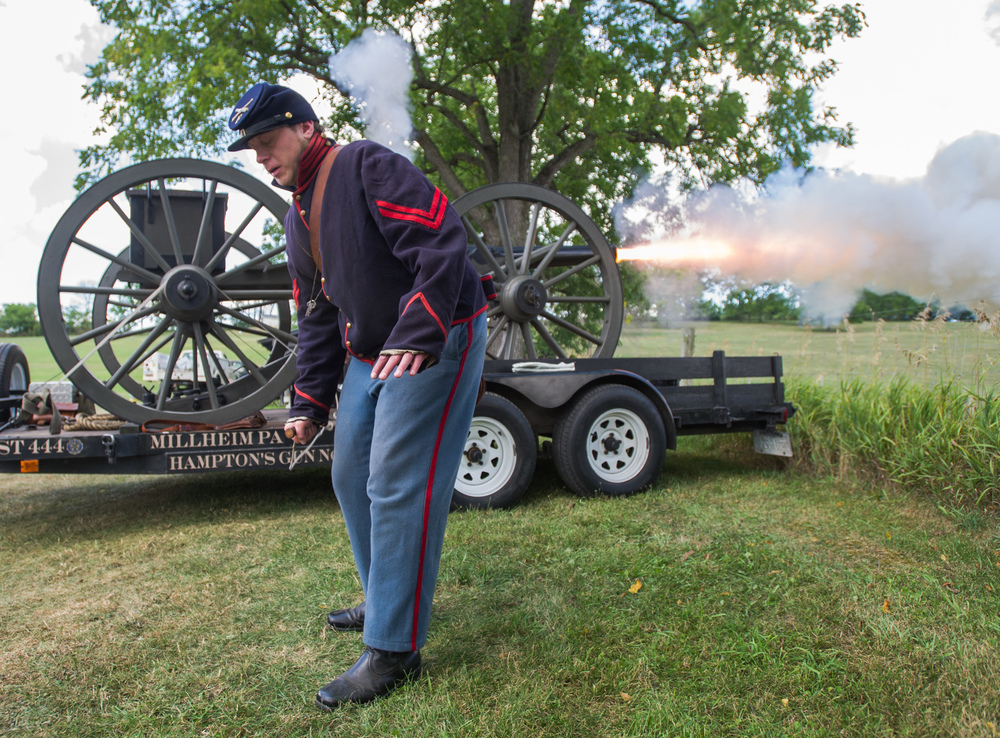 Corporal Jimmy Brown of Hampton Battery F fires their cannon at the start of the Gregg Township safety awareness event held at the Gregg Township Fire Company carnival grounds on Saturday, Aug. 6, 2016.