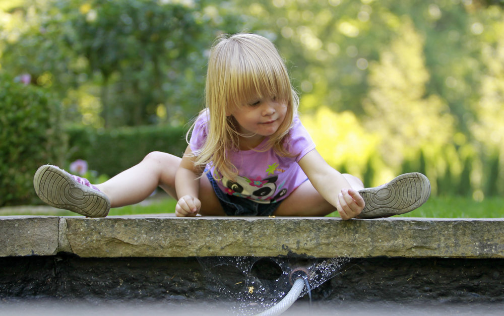 Sophia Wilmoth, 2, inspects the inner wall of the fountain in the garden of the Manor House in the Wildwood Metropark on Tuesday, Sept. 13, 2016 in Toledo. Sophia and her father Matt Wilmoth live at an apartment nearby and use the park as a yard to play in.