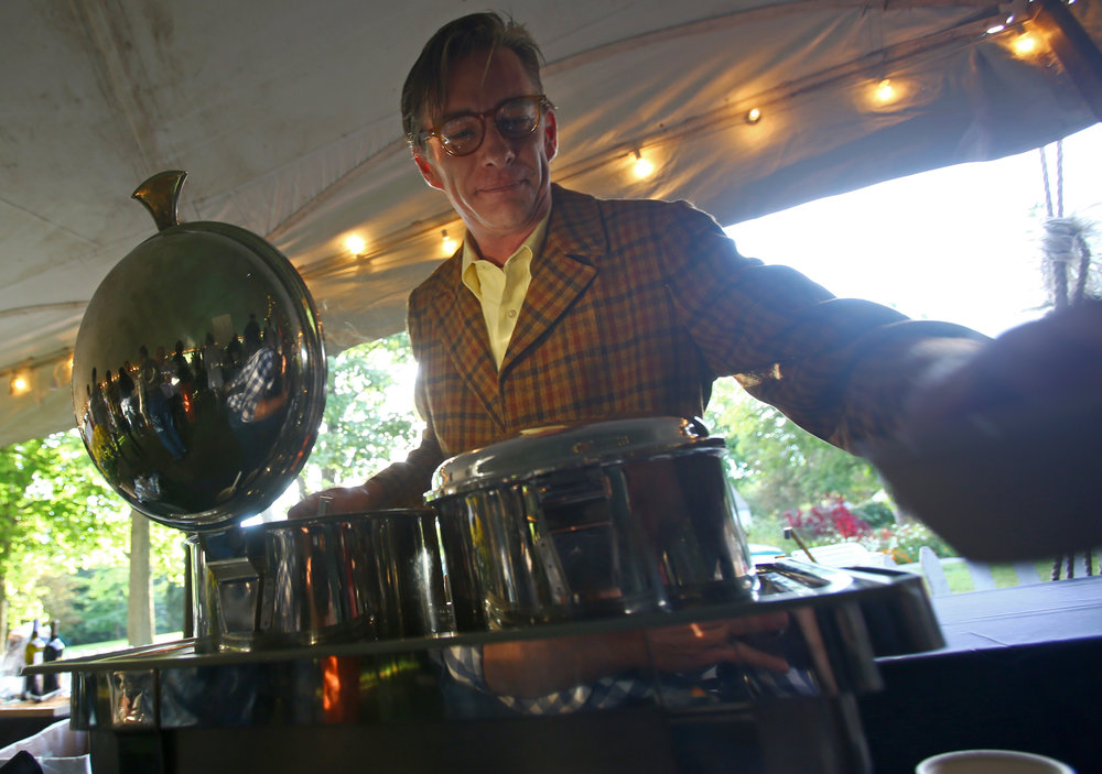 Steve Moss scoops cups of mulligatawny soup at the Pam's Corner booth during the Toledo Grows Harvest Market Dinner held at the Toledo Botanical Gardens on Thursday, Sept. 15, 2016.