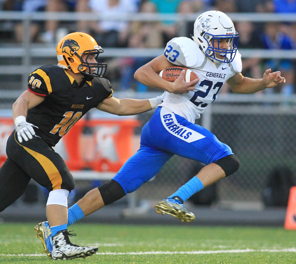 Anthony Wayne High School sophomore wide receiver Max Bradfield evades a tackle from Northview High School linebacker Ian Donahue after completing a pass during the game at Northview High School in Sylvania on Friday, Sept. 16, 2016. Anthony Wayne High School won the game 35-14.