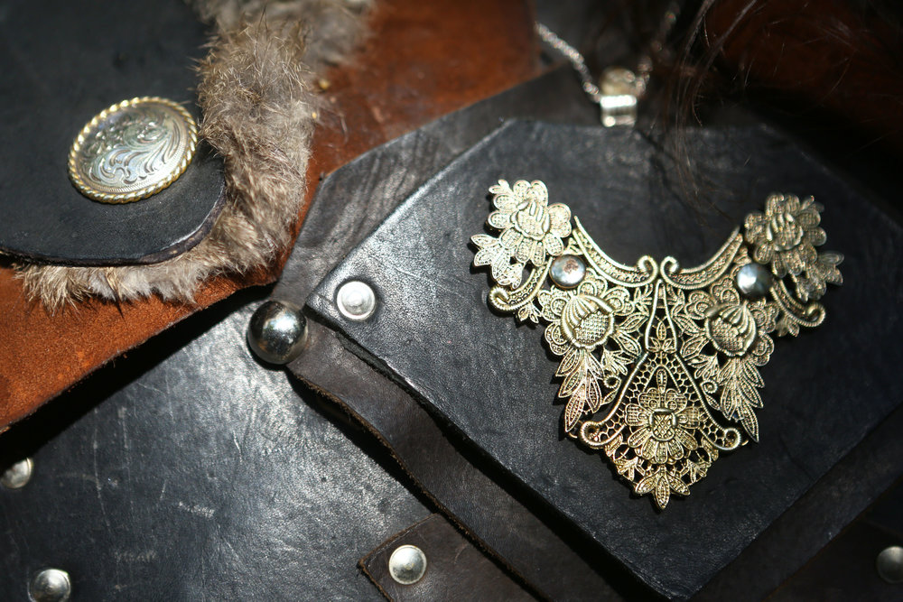 A close up of Steve Armolsch's hand made leather armor photographed at the Michigan Renaissance Festival in Holly Michigan on Sunday, Sept. 18.