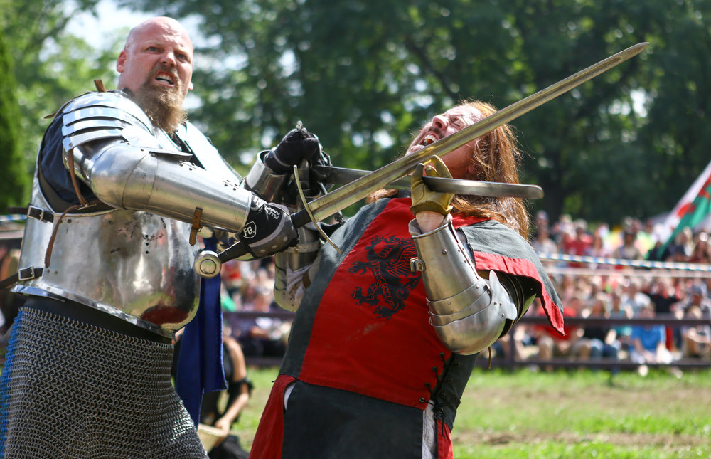 Brian Stephenson of Chelsea, Mi., left, battles with Dale Walter of Howell as part of the jousting demonstration during the Michigan Renaissance Festival in Holly Michigan on Sunday, Sept. 18.