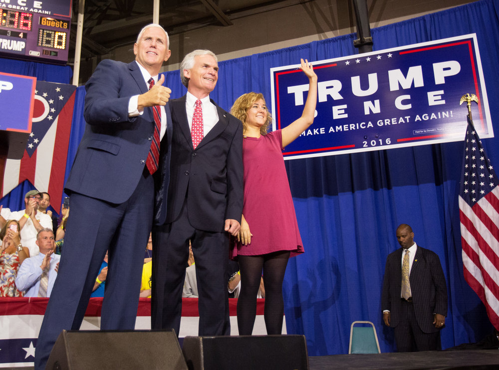 Republican vice presidential candidate Mike Pence, congressman Bob Latta, R-Bowling Green, and Charlotte Pence take the stage during a rally held at the the Rossford Recreation Center on Friday, Oct. 7, 2016.