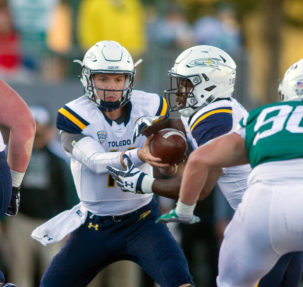University of Toledo junior quarterback hands the ball off to senior running back Kareem Hunt during the football game against Eastern Michigan at Rynearson Stadium in Ypsilanti on Saturday, Oct. 8, 2016. Toledo won the game 35-20.