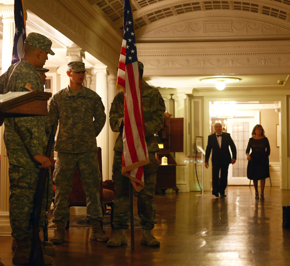 Members of the University of Toledo ROTC wait to post the colors during the President's Dinner held at the Toledo Club in downtown Toledo on Tuesday, Oct. 18, 2016.