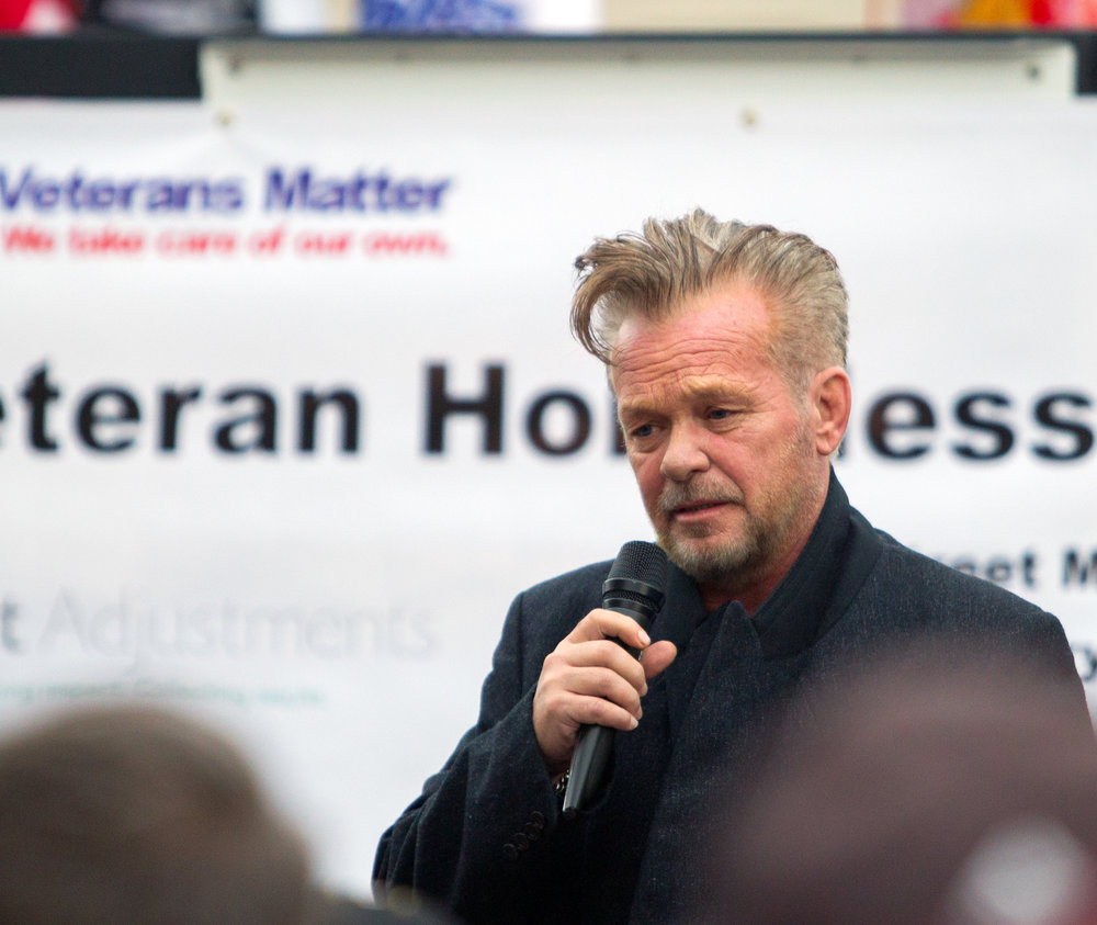 Tent City honorary mayor John Mellencamp speaks before the Walk to End Veteran Homelessness at the Civic Center Mall in Downtown Toledo on Friday, Oct. 21, 2016.