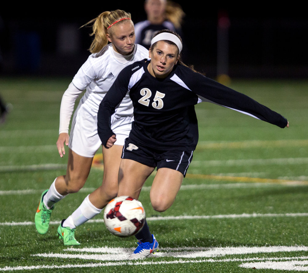 Perrysburg High School's Kristina DeMarco breaks away from Madison High School's Hannah Schmidt during the Division I girls soccer district tournament game at Northview High School Monday, Oct. 24, 2016.