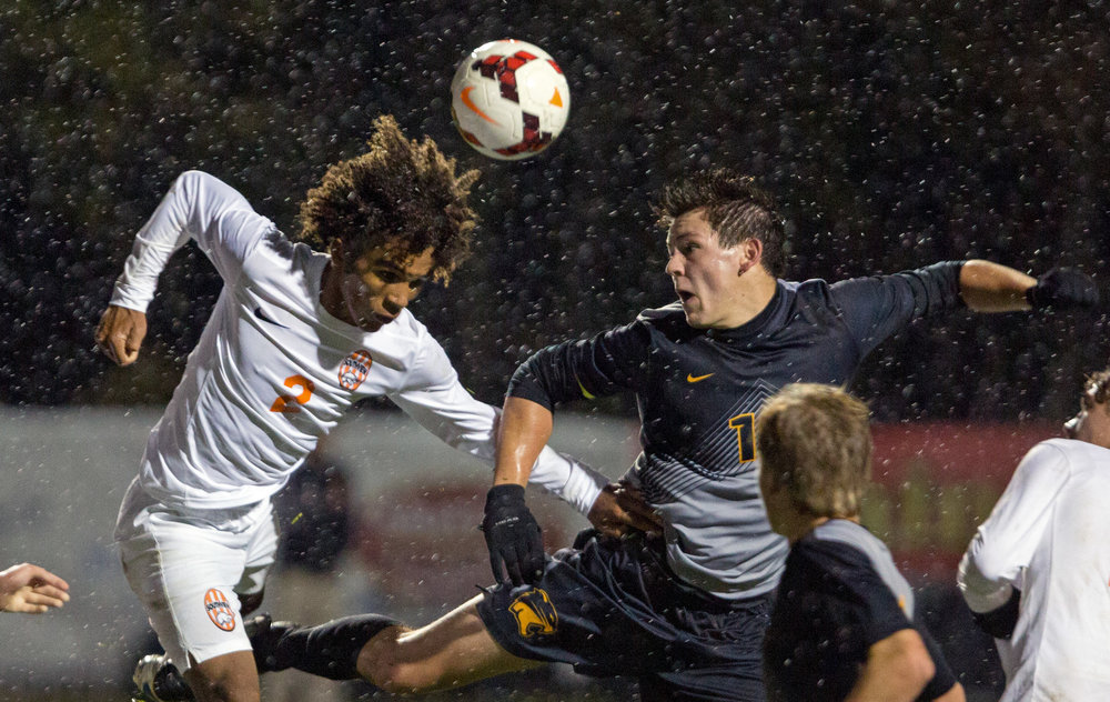 Southview High School defender Alek Christy (2) jumps for a header against Northview high School forward Shane Banachowski (10) during the Div. 1 Boys soccer semifinal game at Southview High School on Wednesday, Oct. 26, 2016.