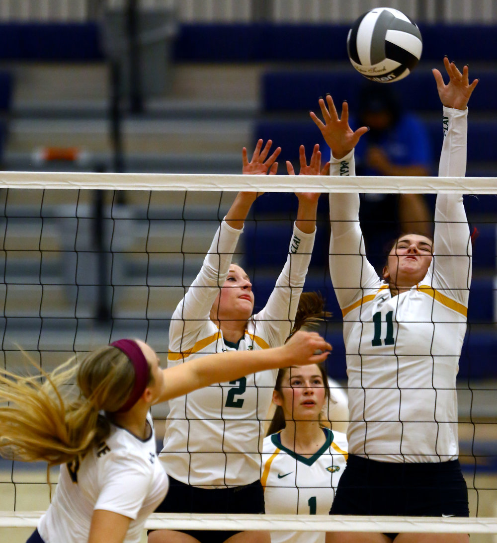 Clay High School setter Abby Batch (2) and middle hitter Alyssa Huffman (11) jump as a hit from Notre Dame Academy right side hitter Cassandra Calamunci goes over their block during the Div. 1 volleyball district final at Lake High School in Millbury, Oh. on Saturday, Oct. 29, 2016. Notre Dame Academy won the match 3-0.