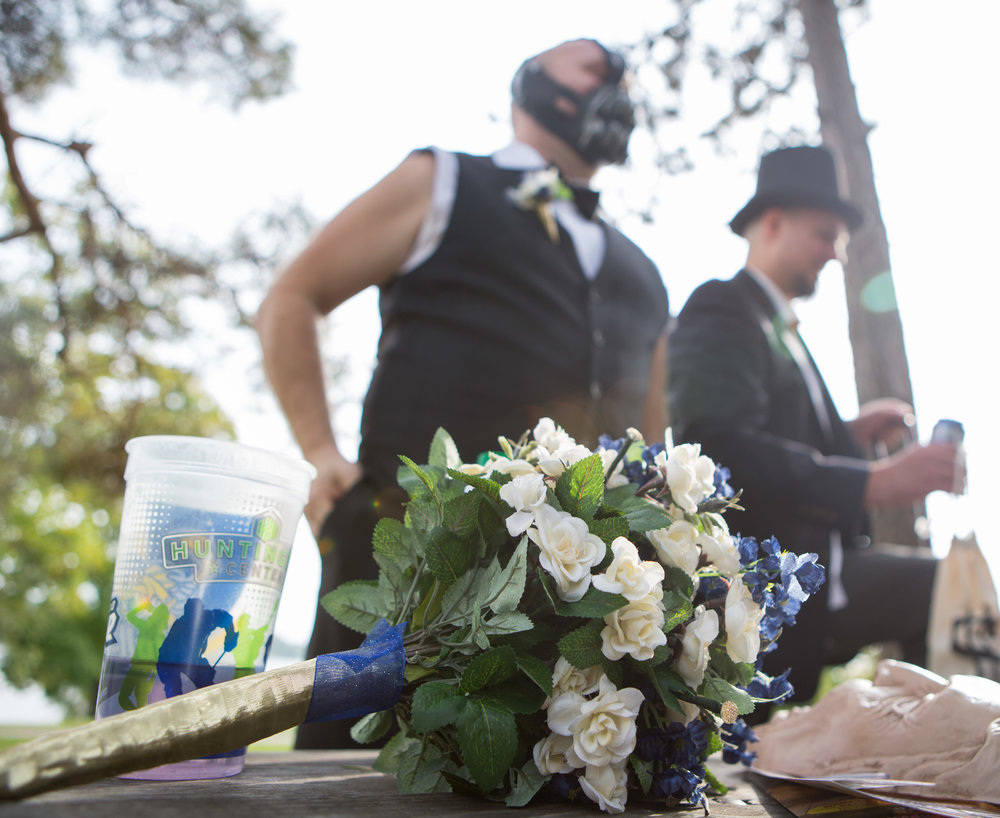 Groomsmen Steve Van Etten, left, and Mike Nowacki stand by a picnic table in Halloween costumes in Walbridge Park before participating in a wedding ceremony on Saturday, Oct. 29, 2016.