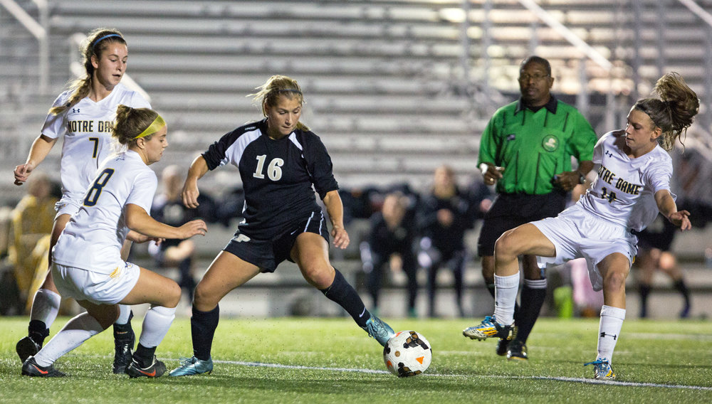 Perrysburg High School forward Anna Kirby (16) is boxed in by Notre Dame forward Casey Paluch (8), and midfielders Emily Kozak (7) and Alyssa Stark (14) during the Div. 1 regional semi-final girls soccer game at Lake High School in Millbury, Oh. on Tuesday, Nov. 1, 2016. Notre Dame won the game 3-2.