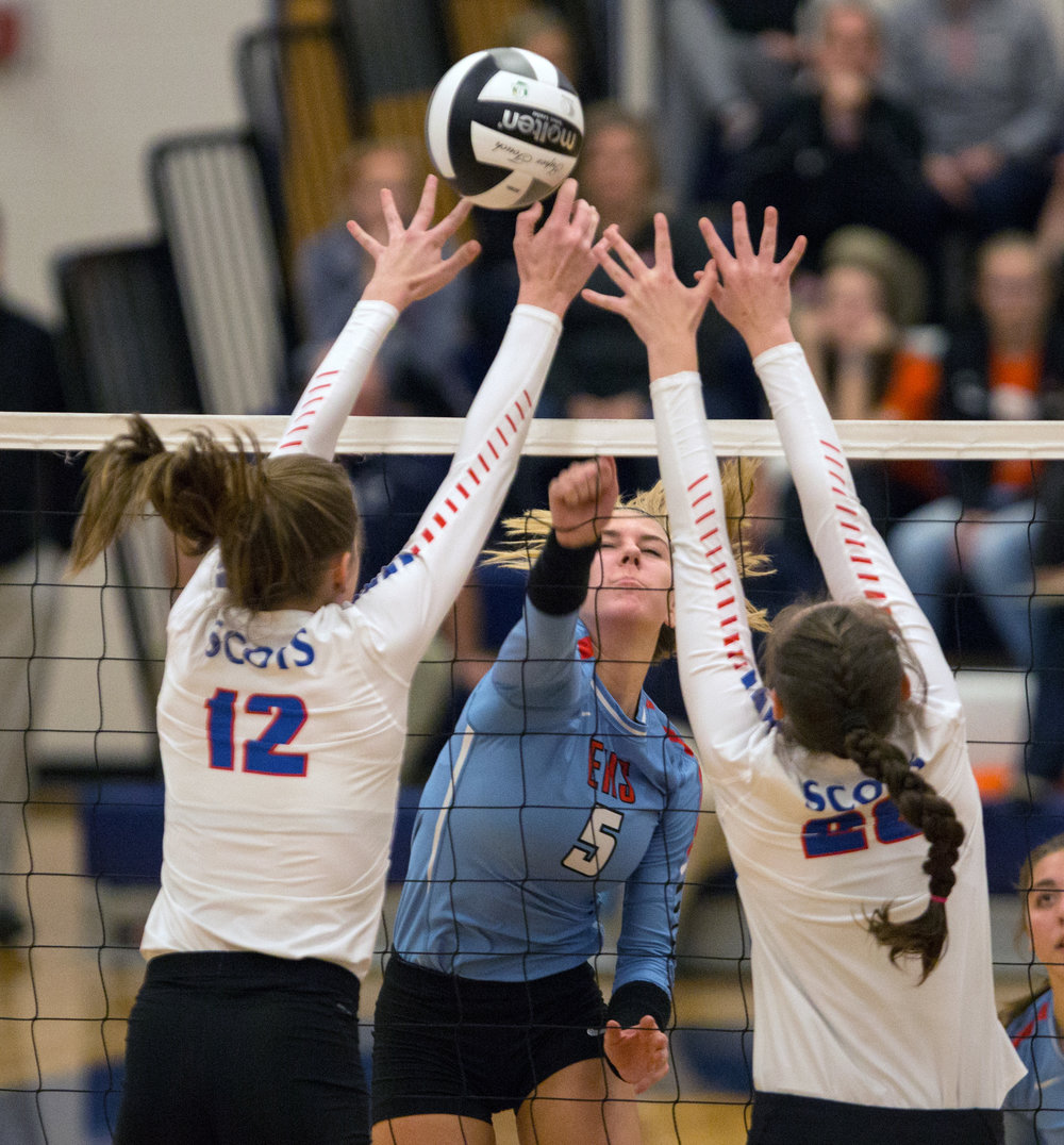 Eastwood High School setter Abby Schroeder's (5) hit is blocked by Highland High School outside hitter Raina Terry (12) and middle hitter Gena West (28) during the Div. 3 volleyball final at Lake High School on Thursday, Oct. 3, 2016. Highland High School won the match 3-0.