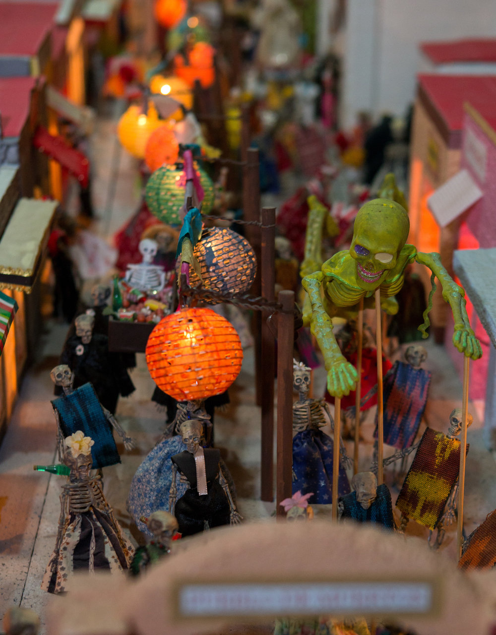 A model Day of the Dead town created by Kristen Snodglass on display in the Jose Martines Memorial Galeria during the Sofía Quintero Art and Cultural Center's 20th annual Day of the Dead celebration at on Broadway St. in Toledo on Saturday, Nov. 5, 2016.