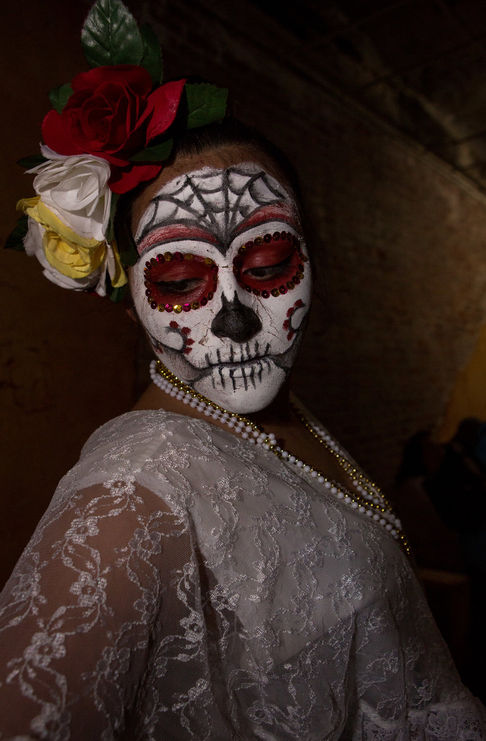 Cecillia Montoya of Toledo poses after having her make up done to perform with the Ballet Folklorico Imagenes Mexicanas during the Sofía Quintero Art and Cultural Center's 20th annual Day of the Dead celebration at on Broadway St. in Toledo on Saturday, Nov. 5, 2016.