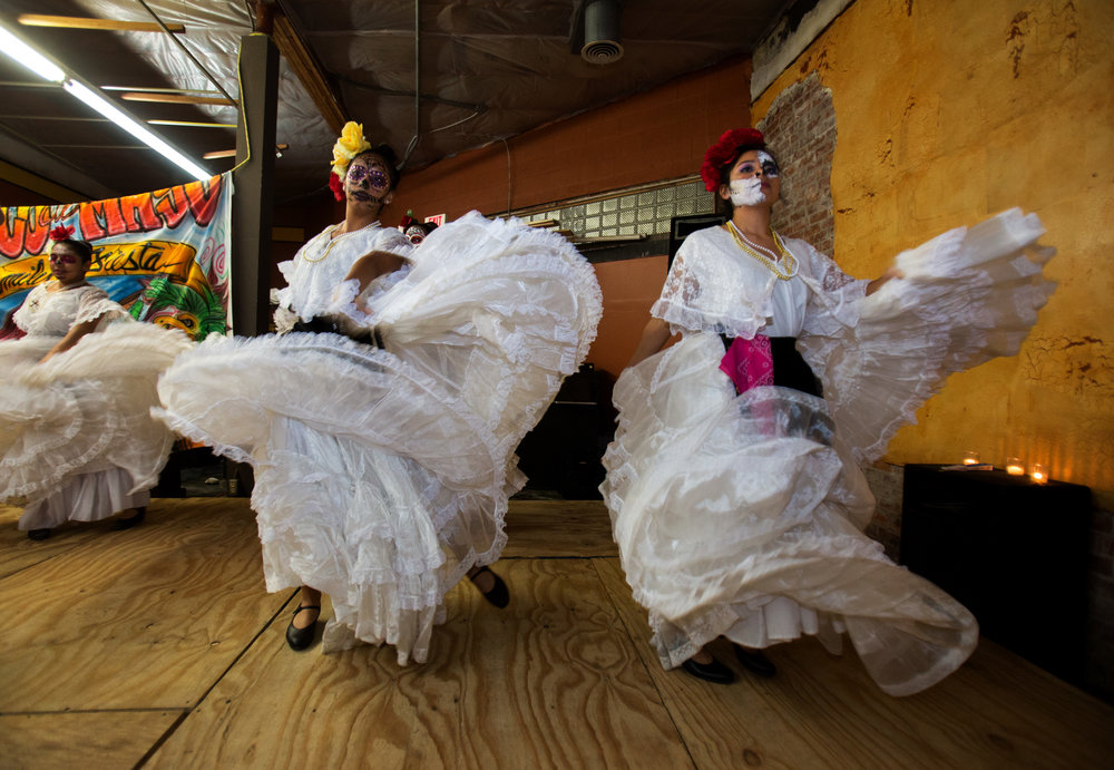 Members of the Ballet Folklorico Imagenes Mexicanas Isabel Huembes, left, and Alicia Gonzalez, dance in the Jose Martinez Memorial Galeria during the Sofía Quintero Art and Cultural Center's 20th annual Day of the Dead celebration at on Broadway St. in Toledo on Saturday, Nov. 5, 2016.