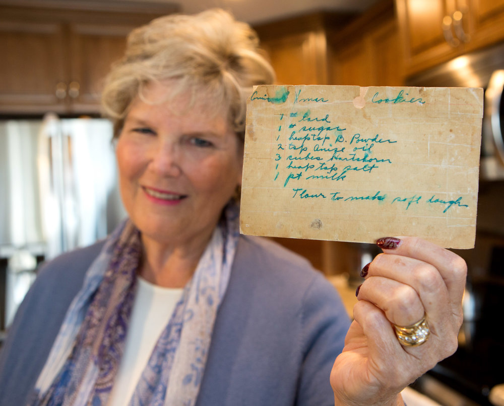 Amy Bless holds up the family recipe for anise cookies passed down through the family for six generations in Perrysburg, Oh. on Friday, Nov. 11, 2016.