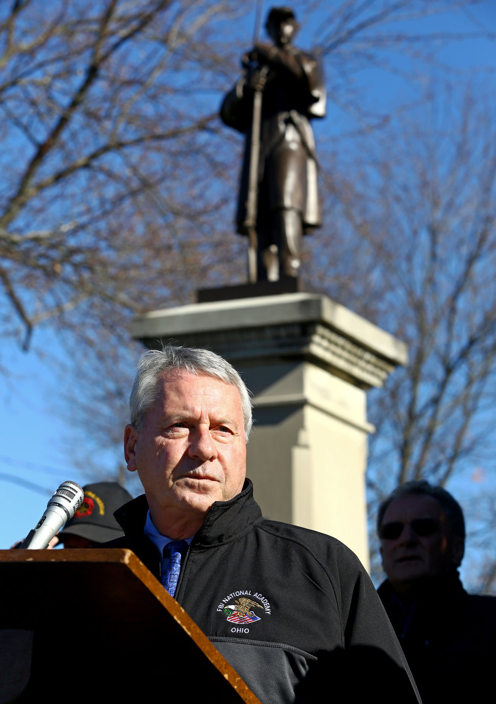Mayor of Whitehouse Don Atkinson addresses the crowd gathered in Whitehouse Village Park during a re-dedication ceremony for the Soldier Statue in Whitehouse, Oh. on Saturday, Nov. 12, 2016. The statue originally dedicated on July 4, 1900, was recently removed from the base to be restored and refinished by McKay Lodge Fine Arts Conservatory.