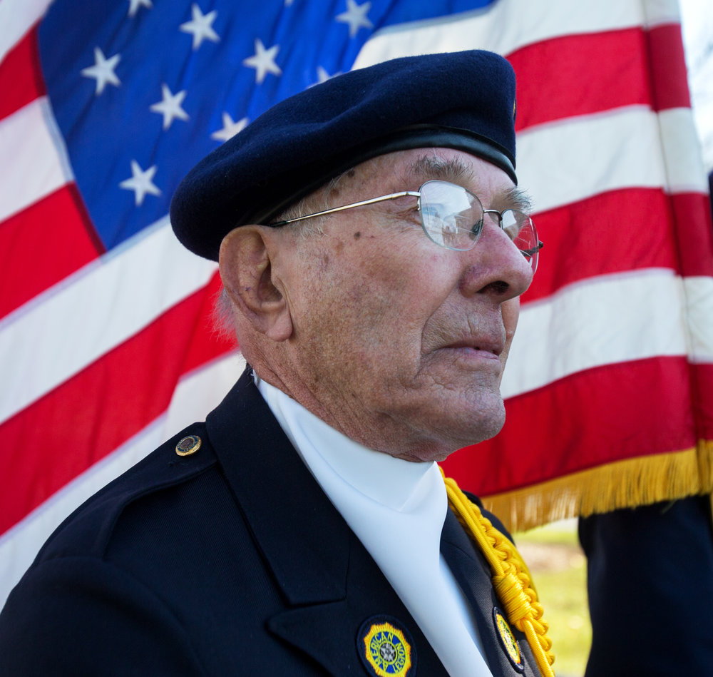 American Legion post 384 color guard member Leroy Ryerson of Whitehouse stands at attention with other members of the color guard during a re-dedication ceremony for the Soldier Statue in Whitehouse Village Park in Whitehouse, Oh. on Saturday, Nov. 12, 2016.