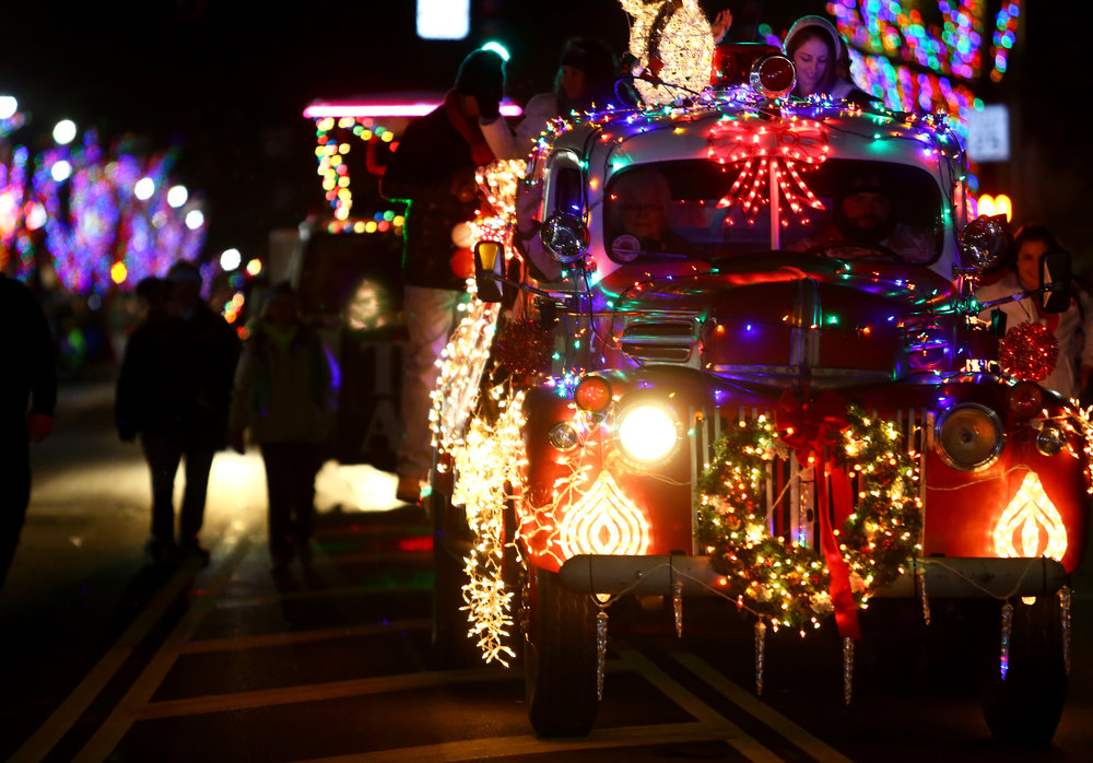 A vintage fire engine decorated in christmas lights is driven down Conant St. in the annual Maumee Holiday Lights Parade through downtown Maumee, Oh. on Saturday, Nov. 26, 2016.