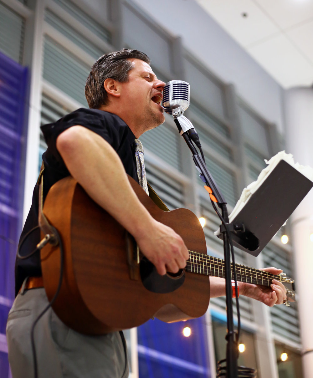 Penta Career Center health and physical education teacher and local musician Dave Carpenter performs acoustic covers of pop songs during the annual Penta Career Center Scholarship Dinner at the Penta Career Center in Perrysburg, Oh. on Thursday, Dec. 1, 2016.