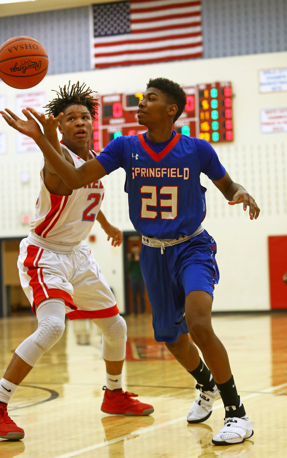 Bowsher High School's Darryl Robinson, left, reaches for the ball that Springfield High School's Denzel Prince loses control of during the boys basketball game at Bowsher High School in Toledo, Oh. on Thursday, Dec. 1, 2016.