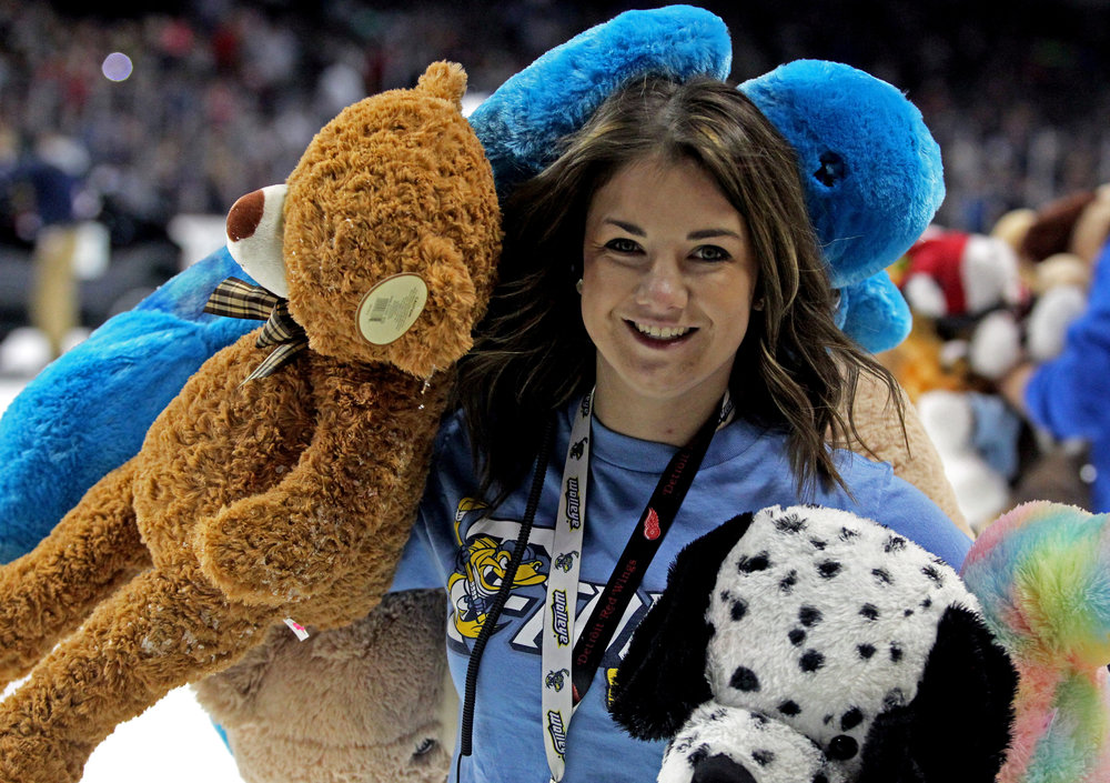 Toledo Walleye Pond Patrol member Ashely Lonsway of Bedford, Mi. carries handfuls of teddy bears off of the ice to be donated to local charities after the annual Teddy Bear Toss during the Walleye game against the Quad City Mallards at the Huntington Center on Saturday, Dec. 3, 2016.