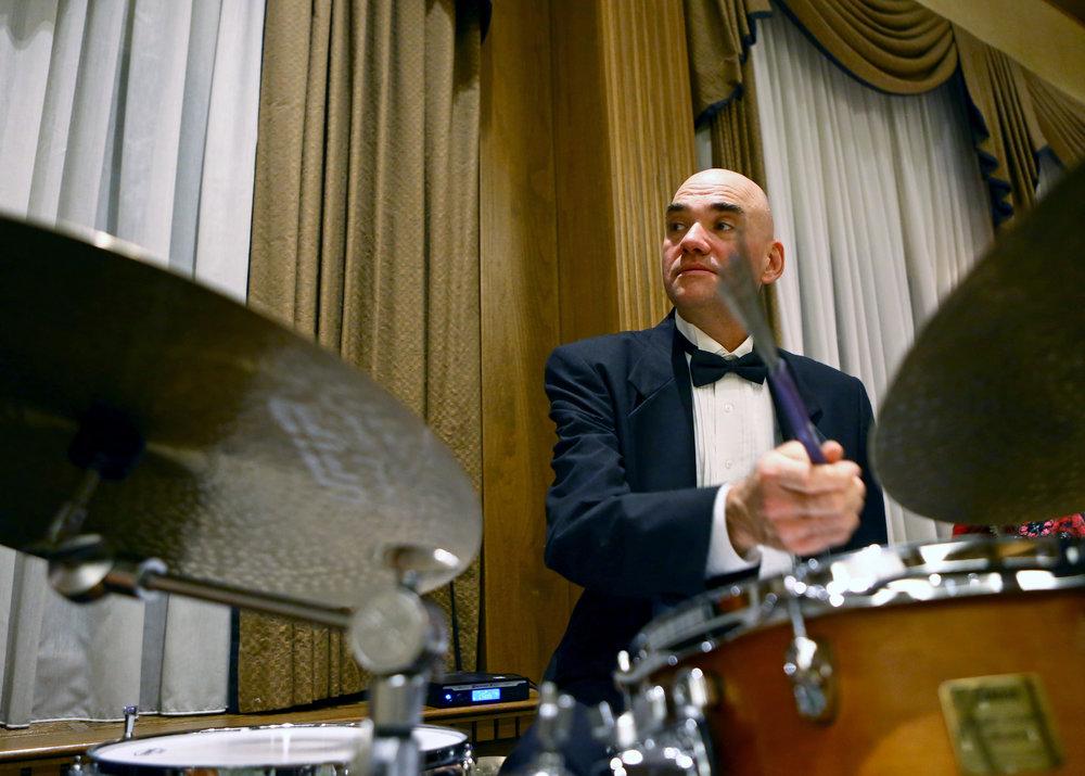 Scott Kretzer performs with the Toledo Symphony Trio during the Toledo Symphony Tux and Trees formal fund raiser at the Toledo Club on Friday, Dec. 2, 2016.