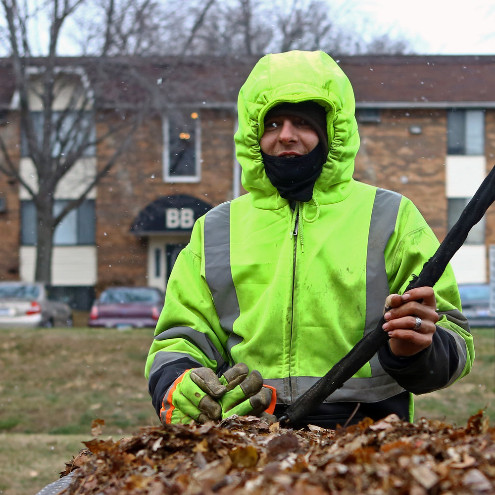 Joey Smith of Delta is bundled up while working with Total Package Landscaping clearing leaves from the Hunter's Ridge apartment complex on Byrne Rd. in Toledo on Thursday, Dec. 8, 2016.